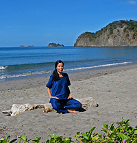Diksha meditates on the beach