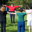 A group doing Yogananda's energization exercises
