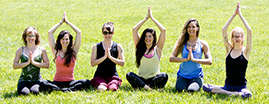 ananda yoga group sitting in grass