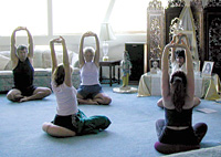Yoga postures in a nice, blue-carpeted room