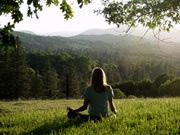 Meditation at sunset ridge. Forests abundant with wildlife surround our retreat center and community