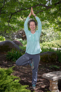 Maitri doing tree pose near the pond