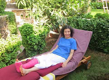 Rest in lounger with cast Diksha in Keralaen Ayurvedic Resort with Ananda Travels