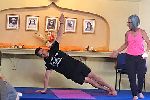 Melody-yoga-for-sleep--student-Matt-in-class-with-Michele
