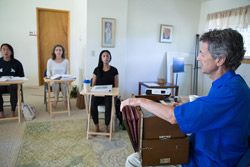 Ananda Meditation Teacher Training -Gyandev playing harmonium.