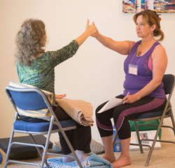 Ananda Meditation Teacher Training student thumbs-up.