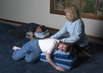 lisa adjusting restorative yoga pose