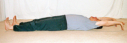Student lying on his back, stretching out