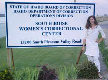 Nikki standing in front of the sign for the correctional center
