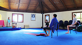 Karma Yoga spiritual interns during guided morning sadhana