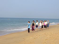 Group walking meditation in Kerala with Ananda Travels