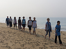 Enjoy a walking meditation on the beach in Kerala, India with Ananda Travels
