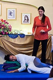 Melody demonstrating Restorative Yoga pose