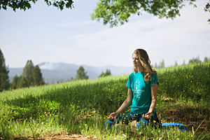 meditator in the meadow expanding light retreat