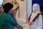 Sraddha in front of Yogananda's statue